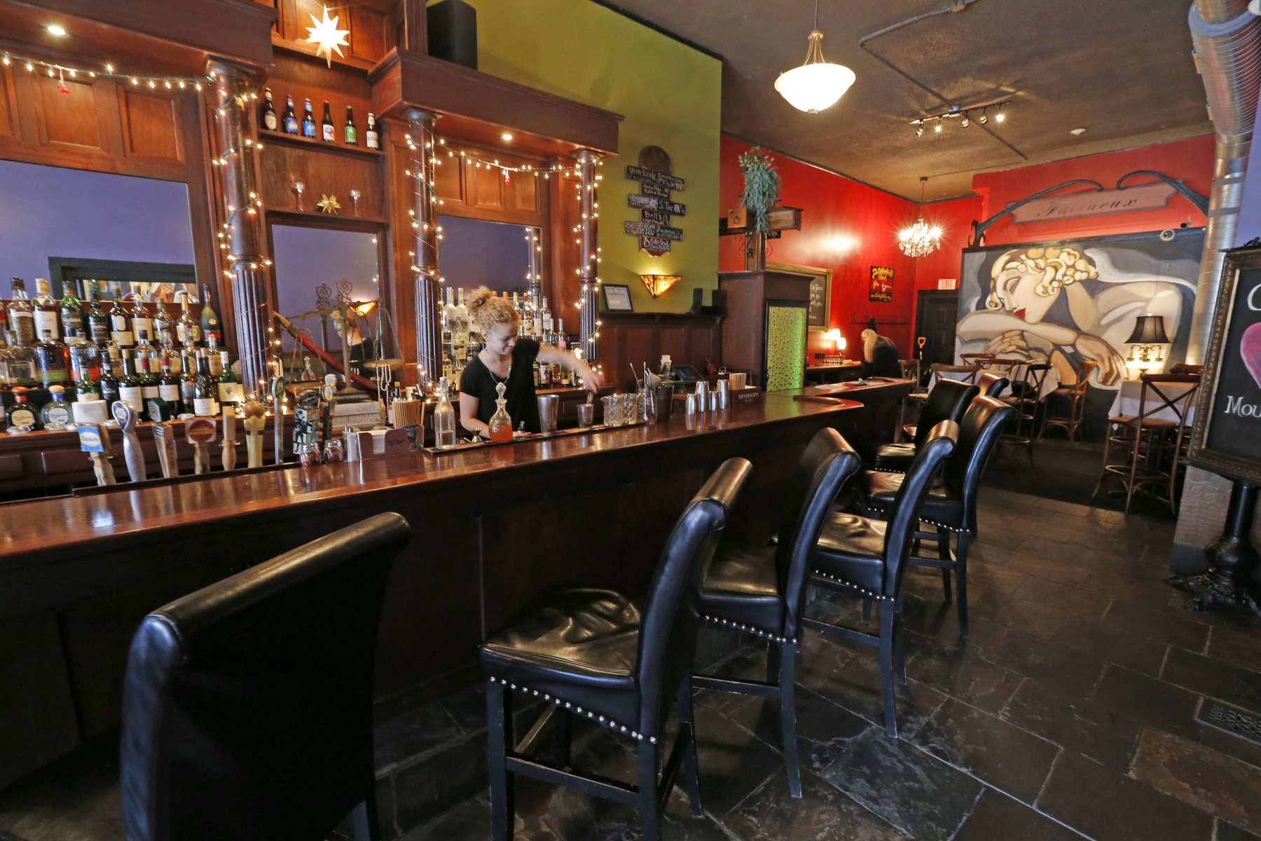 Let the mural on the back wall at Coco be your inspiration for a night out on your own. (Robert Kirkham/News file photo)