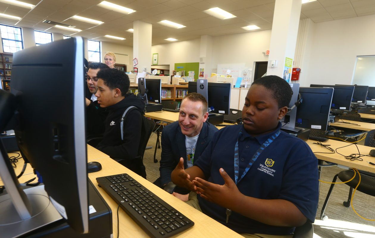 M&T Bank chief information officer Michael Wisler, left, listens to coding club member Isaiah Young. (John Hickey/Buffalo News)