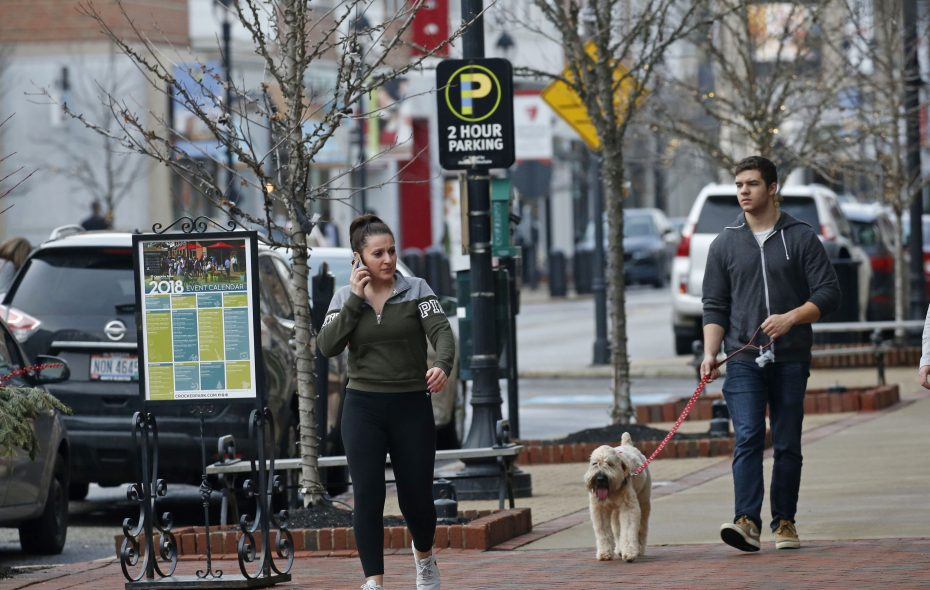 Pedestrians walk the Crocker Park town center near Cleveland in February 2018.   (Robert Kirkham/Buffalo News)