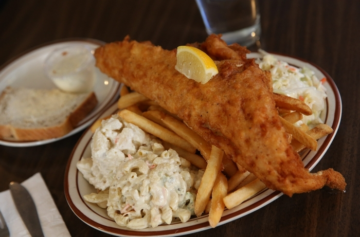 A classic Buffalo fish fry has haddock that hangs over the plate. (Sharon Cantillon/News file photo)