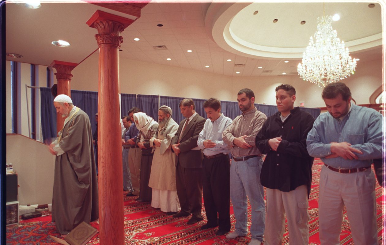 ImamAgwa leads a prayer service at the Islamic Society of Niagara Frontier, on Heim Road in Amherst in 2013. (Harry Scull, Jr/Buffalo News file photo)
