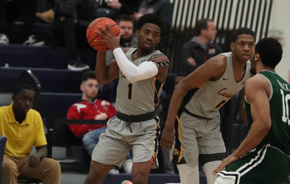 Canisius guard Malik Johnson (1) brings the ball up the court against Manhattan guard Nehemiah Mack on Feb. 17 at the Koessler Athletic Center.(James P. McCoy/Buffalo News)