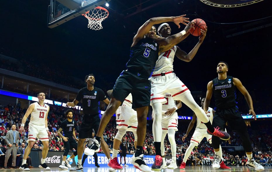 Texas Tech's Tariq Owens grabs a rebound away from Buffalo's CJ Massinburg in the NCAA Tournament on Sunday in Tulsa, Okla. (Getty Images)