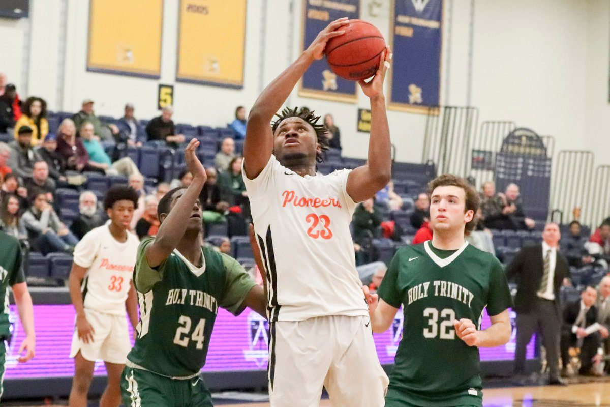 Park's Ebuka Nnagbo rebounds the ball against Holy Trinity's Daniel Kalimian during the second half Saturday at Canisius College. Park won 55-52. (James P. McCoy/The Buffalo News)
