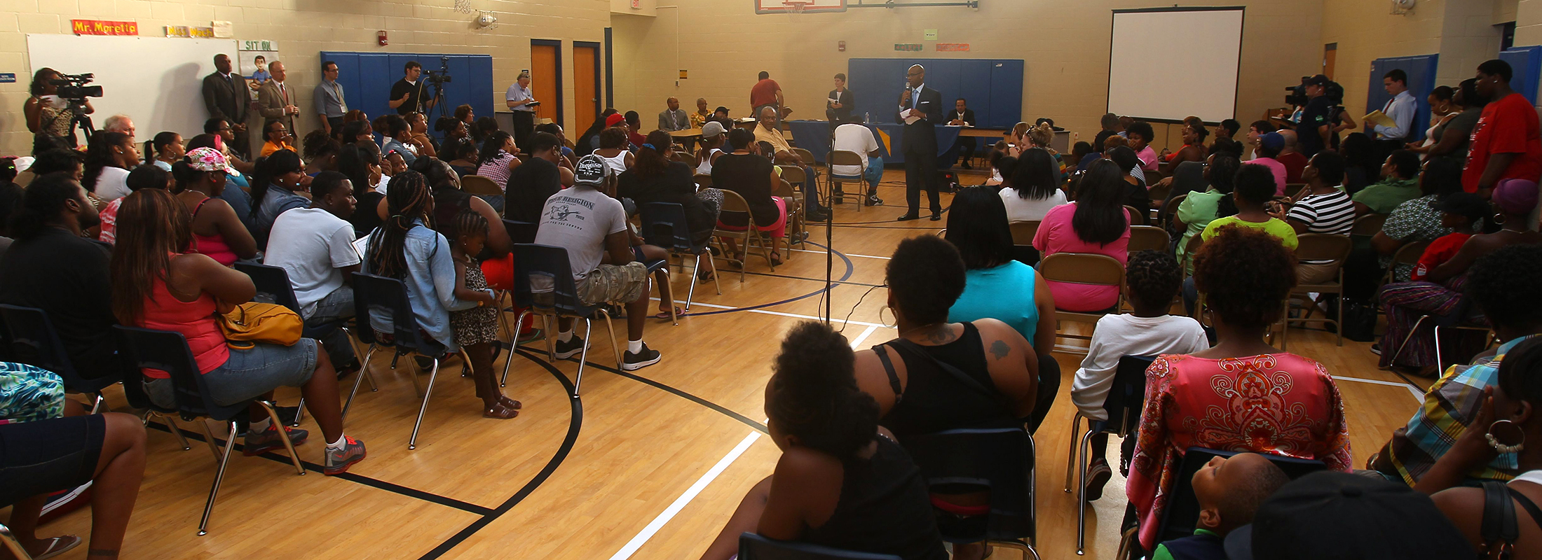 Pinnacle Charter School officials, shown here at a 2013 emergency meeting with parents to try to prevent the school's closing, say they returned more money to the Buffalo Public Schools than the district can account for. (John Hickey/News file photo)