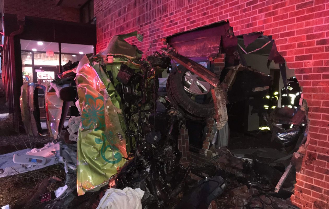 An SUV crashed into the Ken-Ton Presbyterian Village Apartments, a retirement and assisted living facility on Delaware Avenue Tuesday night. (Brighton Volunteer Fire Department photo)