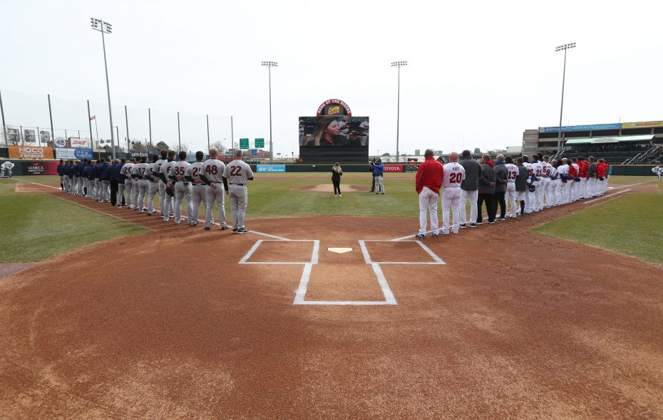 The Buffalo Bisons and Scranton/Wilkes-Barre RailRiders stand for the National Anthem during Opening Day ceremonies at Sahlen Field Thursday (James P. McCoy/Buffalo News)