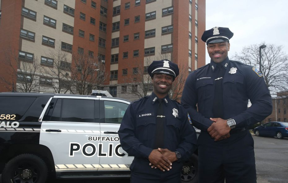 """Buffalo's """"singing cops"""" –  """"Moe"""" Badger, left,  and Michael Norwood Jr. – were featured on Kenmore native Jeff Glor's """"CBS Evening News"""" broadcast Tuesday, just weeks after appearing on Ellen DeGeneres' show.   (John Hickey/Buffalo News)"""