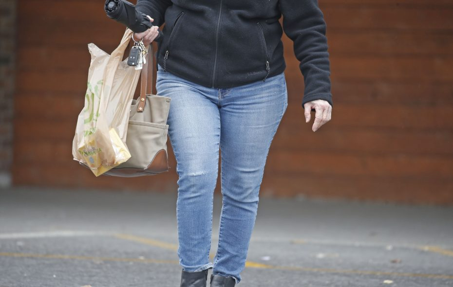 A shopper carries a plastic grocery bag after shopping at Wegmans on Transit Road in Depew. (Robert Kirkham/Buffalo News)