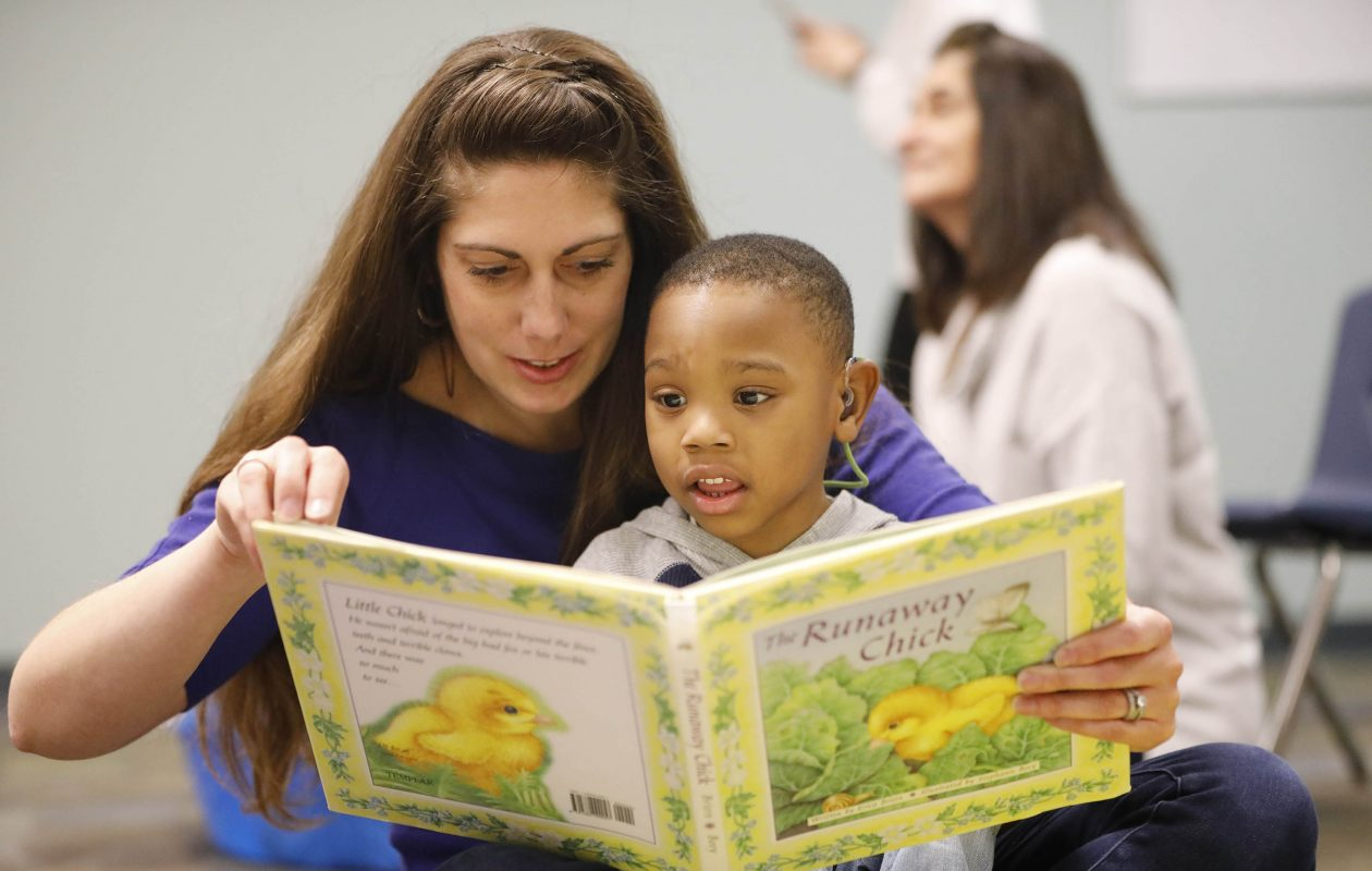 Teacher Julie Celotto reads to 3-year-old Alija Barber in the Early Childhood Program at the Buffalo Hearing and Speech Center during last week's kickoff of the annual Books for Kids campaign. (Derek Gee/Buffalo News)