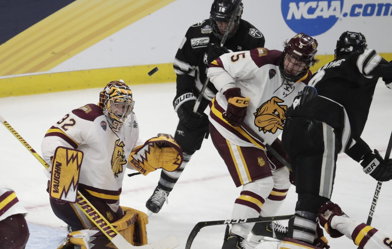 Minnesota Duluth goaltender Hunter Shepard makes a save against Providence during the third period of Thursday's national semifinal game at KeyBank Center. (Harry Scull Jr./Buffalo News)