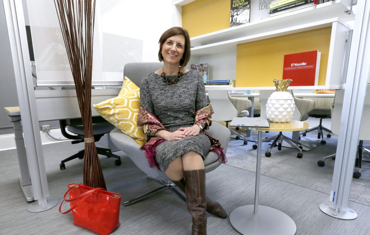 Mimi Harris Steadman, vice president for academic affairs at D'Youville College, takes a seat in the Institute for Teaching Innovation on the second floor of the Koessler Administration Building. The institute  was founded in December 2017; the new space opened in January 2019. (Robert Kirkham/Buffalo News)