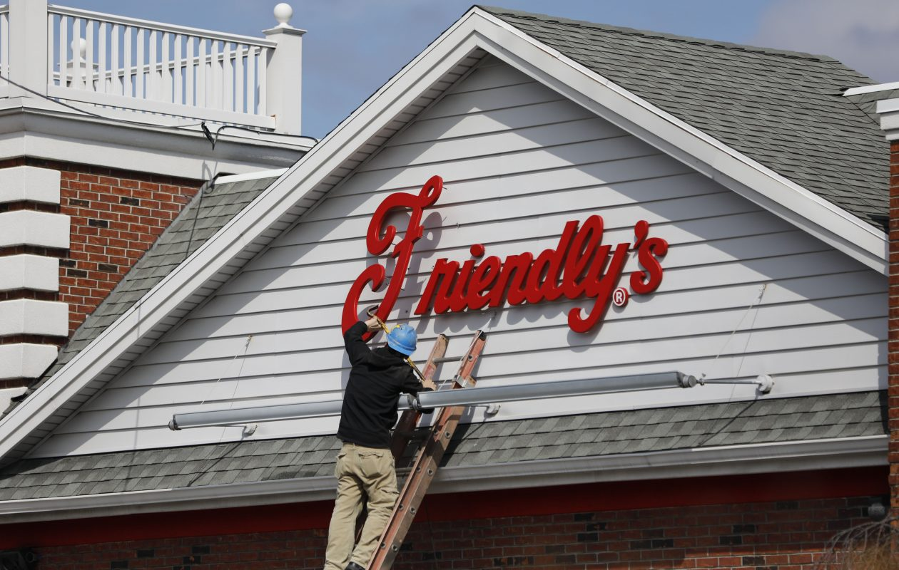 A worker removes the Friendly's sign from above the restaurant on Maple Road after several area Friendly's closed down abruptly earlier this month. (Derek Gee/News file photo)