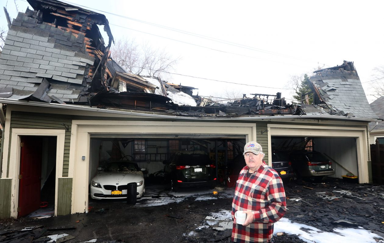 Resident Kurt Sajda talks about the fire that damaged the garage he shares with neighbors at 81-85 Highland on Tuesday, April 9, 2019. (John Hickey/Buffalo News)