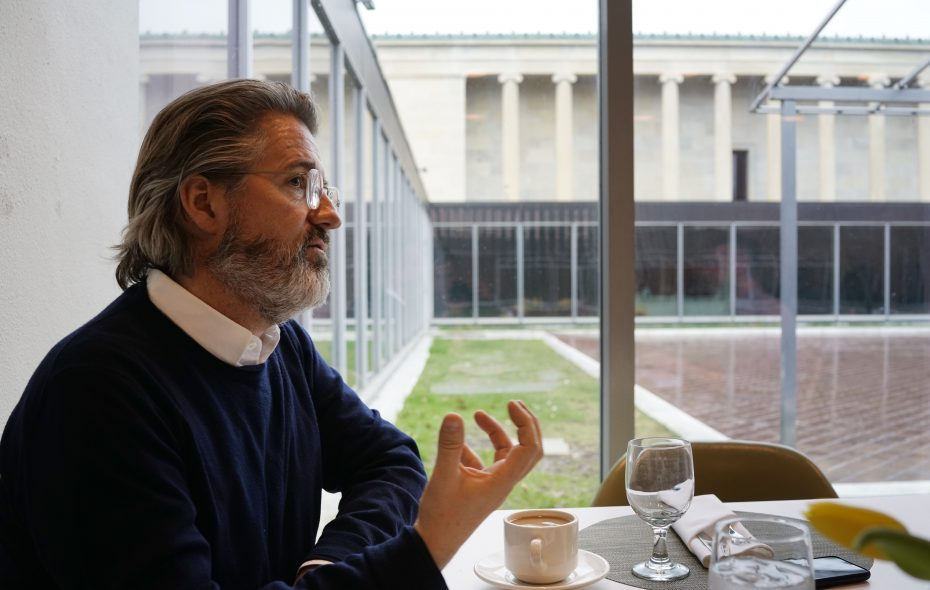 Artist Olafur Eliasson talks to The Buffalo News about his design for a glass roof over the courtyard at the Albright-Knox Art Gallery, background, following a formal announcement of the AK360 design, Thursday, April 11, 2019. (Derek Gee/Buffalo News)