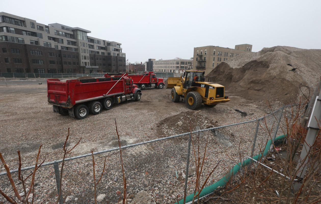 Workers have started removing the dirt pile that neighbors of the Canterbury Woods project have been complaining about. (John Hickey/Buffalo News)