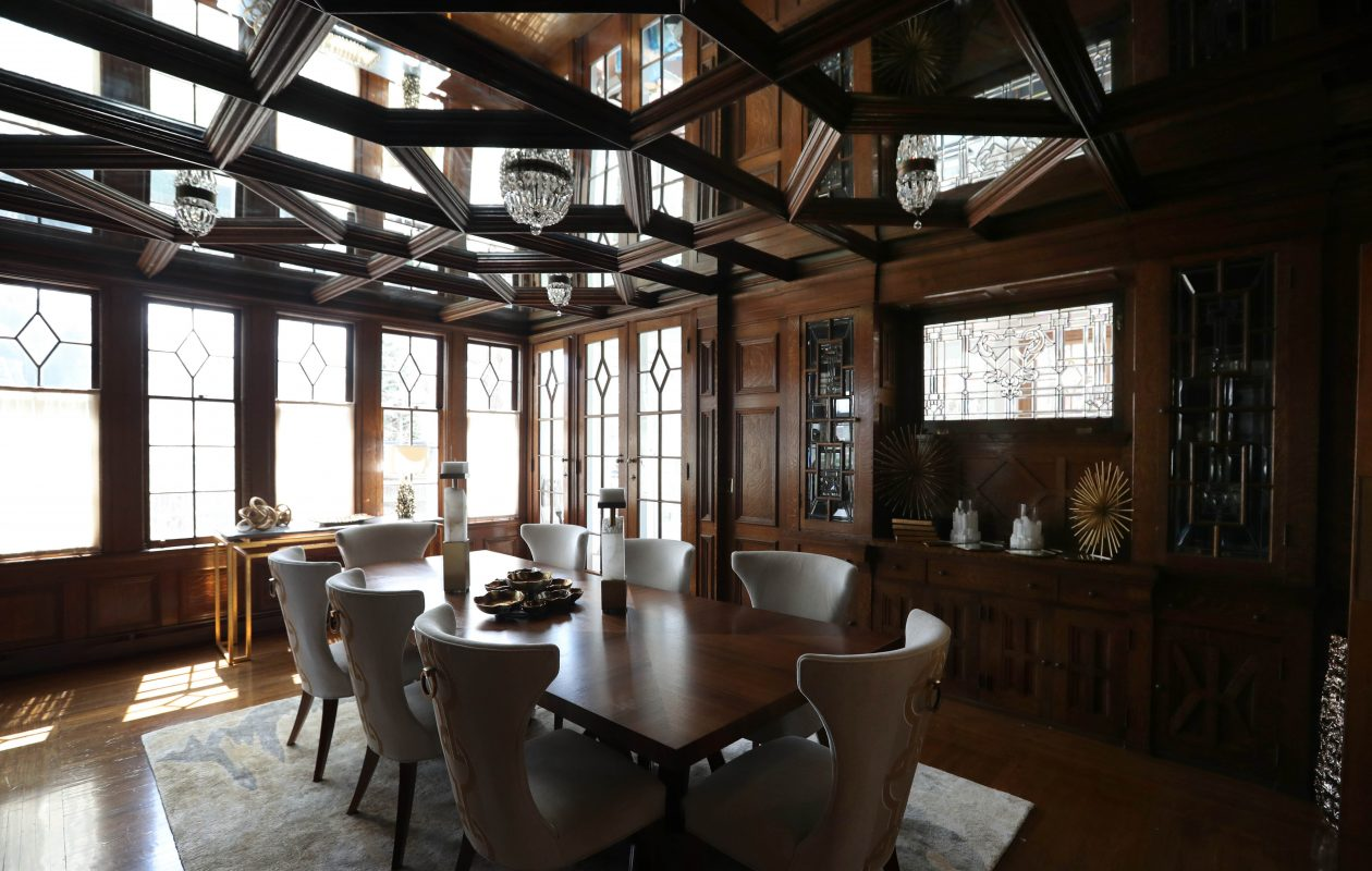 The dining room at the 2019 Decorators' Show House was decorated  by Ray Bialkowski, of Kittinger Furniture Company, with the theme 'A Modern Take on Traditional Kittinger. ' The room features original craftsman details. The ceiling is mirrored. (Sharon Cantillon/Buffalo News)
