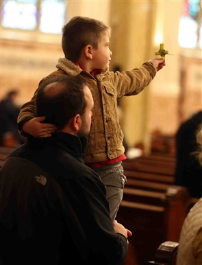 Local Catholics gathered to celebrate Palm Sunday mass at Corpus Christi and St. Joseph's Cathedral.