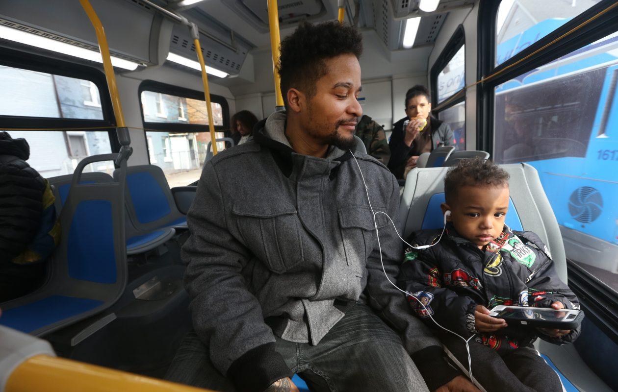 Shawn Saunders  and his 3 year-old son, Shawn Jr., ride the No. 3 bus in Buffalo. (John Hickey/Buffalo News)
