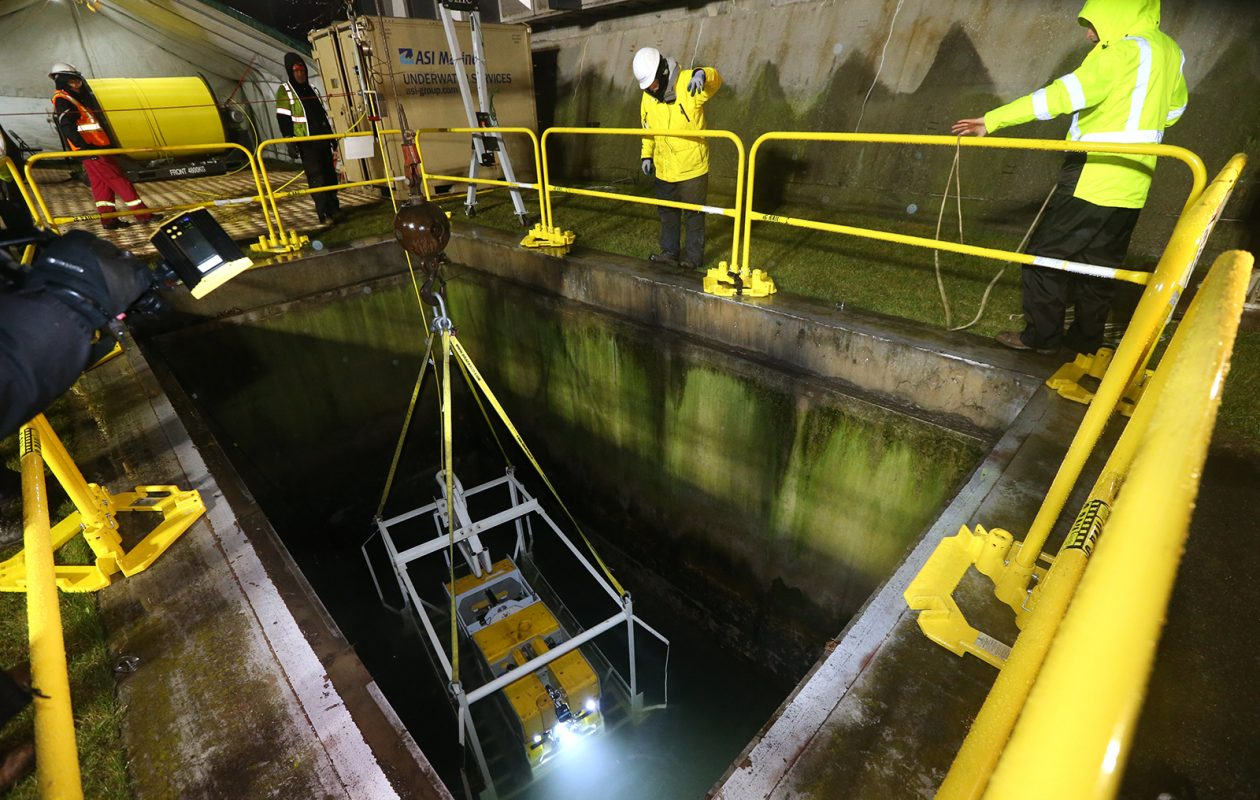 A remote-operated vehicle is lowered into the Intake 2 conduit, which carries water underground from the upper Niagara River to the Niagara Power Project, on April 21, 2019. (John Hickey/Buffalo News)