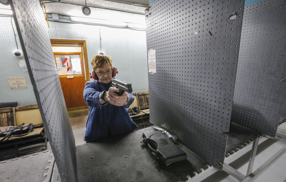 Lois Reid practices at the Mohawk Rifle and Pistol Club with the handgun she just got back five years after being erroneously victimized  by the mental health provisions of New York's SAFE Act. (Derek Gee/Buffalo News)