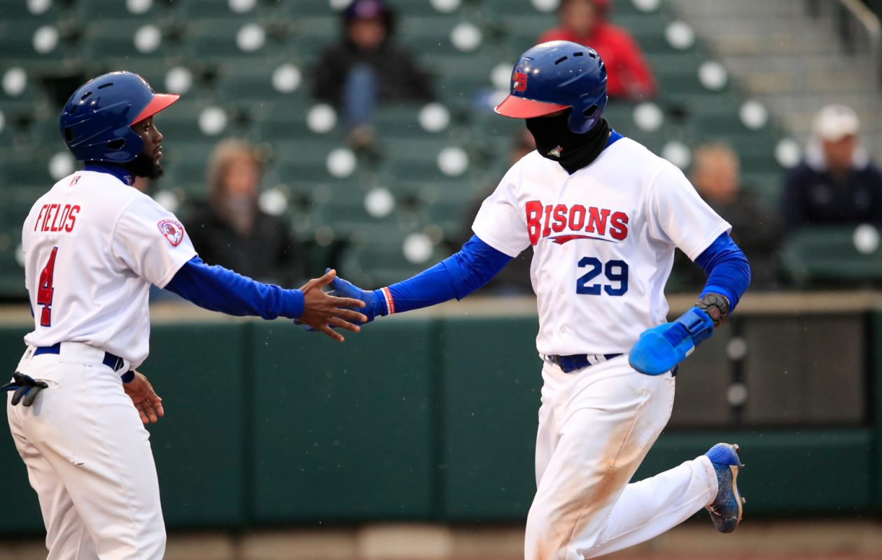 Buffalo Bisons player Lourdes Gurriel Jr. is congratulated by Roemon Fields on his fourth inning run scored against the Pawtucket Red Sox at Sahlen Field on Monday, April 29, 2019. (Harry Scull Jr./Buffalo News)