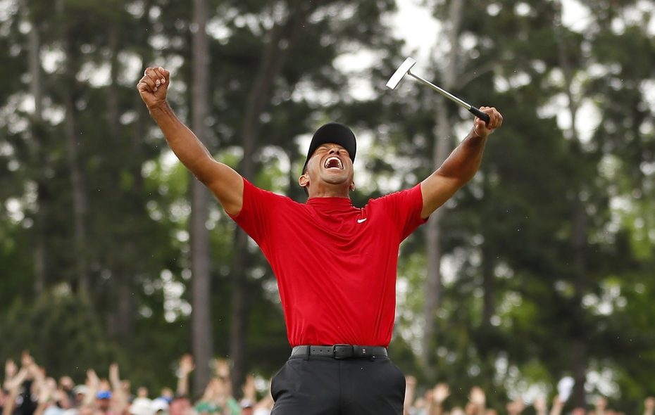 Tiger Woods celebrates after sinking his putt to win during the final round of the Masters at Augusta National Golf Club on April 14, 2019, in Augusta, Georgia. (Getty Images)