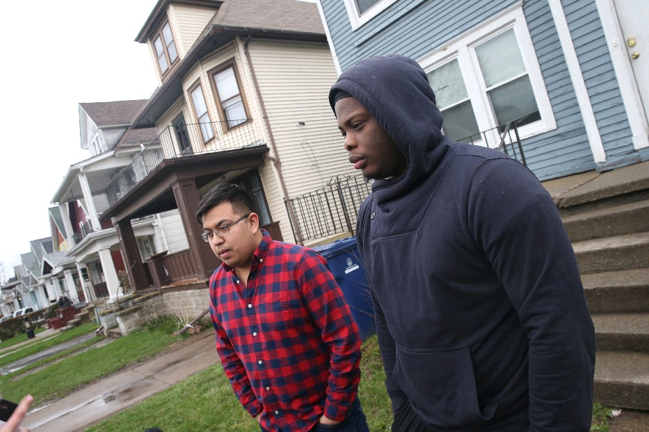 Neighbors Adam Rodriguez, left, and Lavontae Armwood, talk about what they witnessed when a UB student was brought out of a fraternity house next door. Sebastian Serafin-Bazan suffered cardiac arrest on Friday after a possible hazing incident. (John Hickey/Buffalo News)