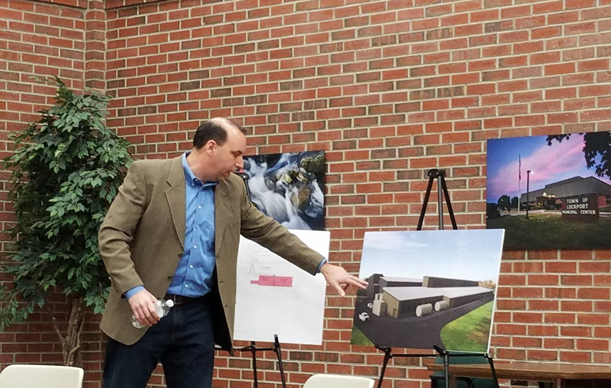 Paul Bonaro, U.S. vice president of data center operations for Verizon Media, displays a rendering of a $28 million expansion of the company's second Lockport data center at a public hearing in Lockport Town Hall April 11, 2019. (Thomas J. Prohaska/Buffalo News)