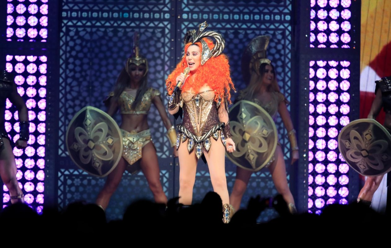 Cher made a grand entrance Friday night in a curly, bright orange wig.  (Harry Scull Jr./Buffalo News)