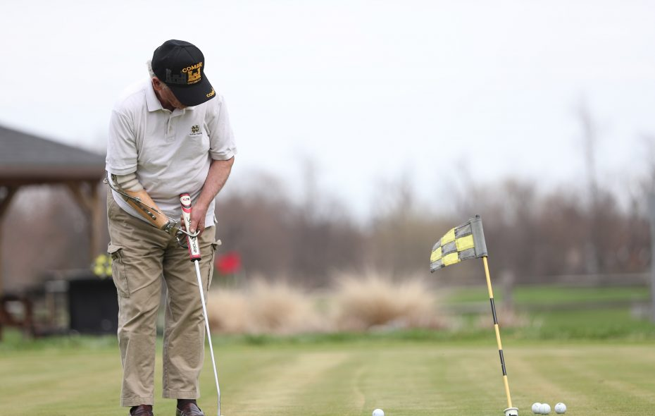 """Chuck """"Sully"""" Sullivan, 74, of Amherst, practices putting at the Amherst Audubon Golf Course. (Sharon Cantillon/Buffalo News)"""