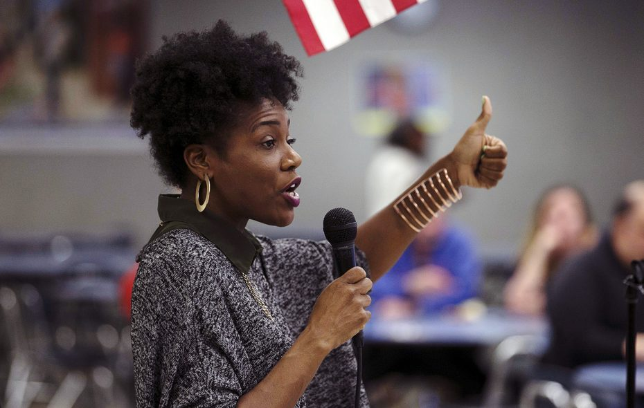 Dasheeda Dawson, president of Flora Buffalo, hosts a community conversation at Southside Elementary on March 26 about education, training and jobs at a proposed cannabis campus in South Buffalo. (John Hickey/Buffalo News)