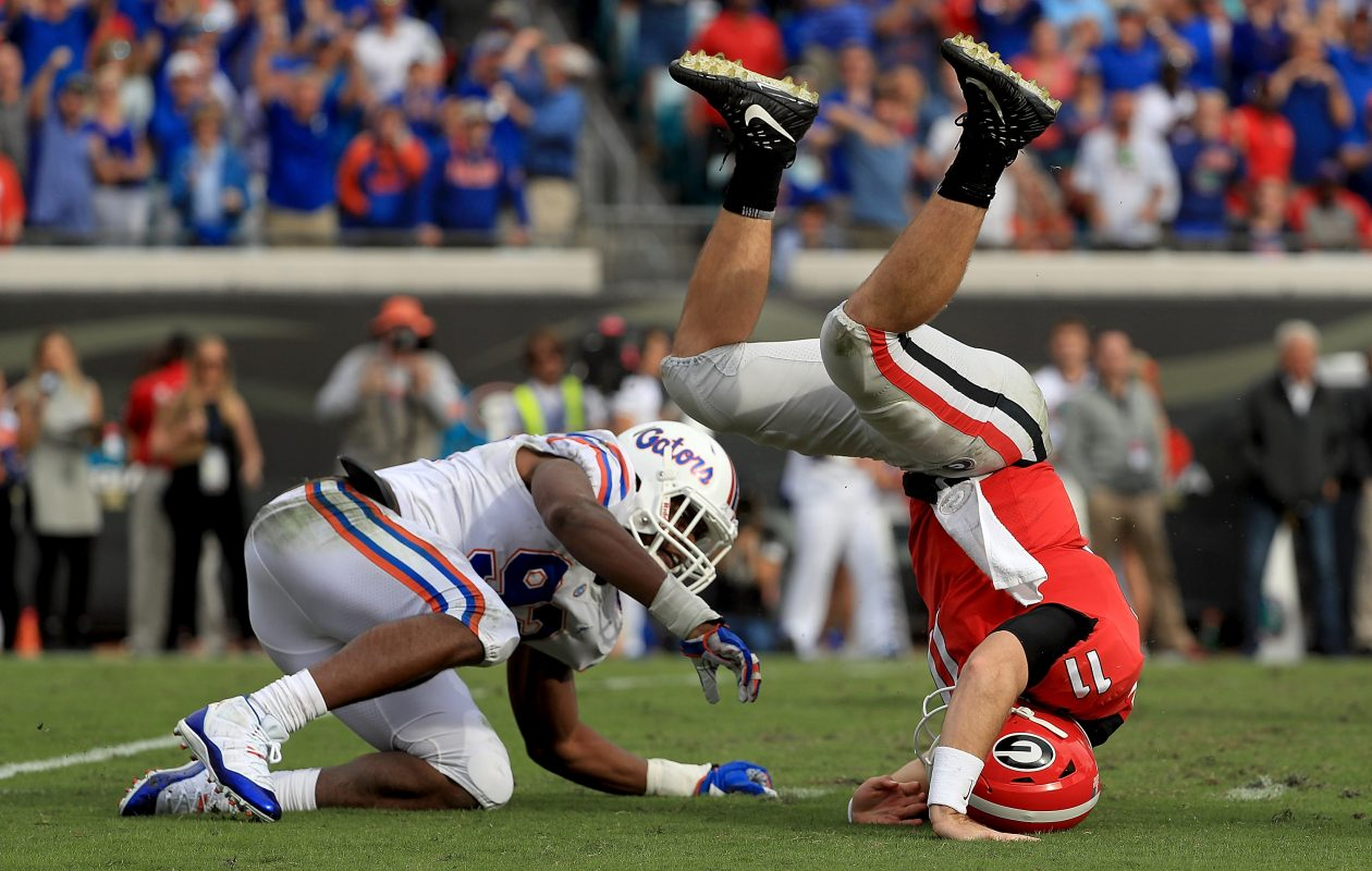 Jake Fromm of Georgia  is sacked by Florida's Vosean Joseph, who was selected by the Bills (Mike Ehrmann/Getty Images)