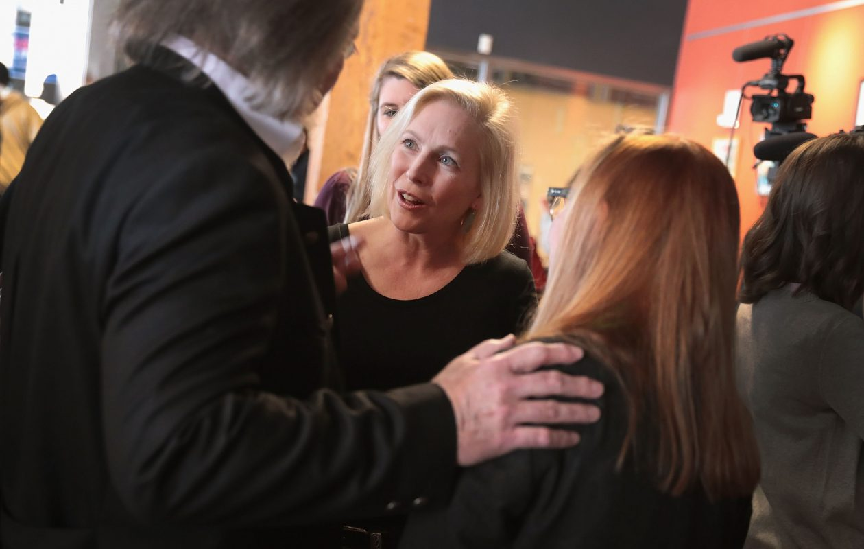 Sen. Kirsten Gillibrand greets guests during a campaign stop  in Dubuque, Iowa, on March 19. Despite several trips to Iowa, she still hasn't exceeded 1 percent in any of the recent polls in the state that will hold the first presidential caucuses.  (Getty Images)