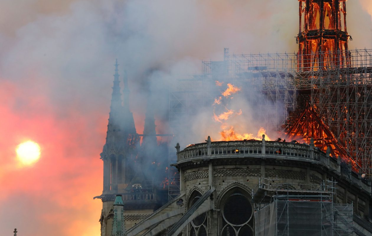 Smoke billows as flames destroy the roof of the landmark Notre-Dame Cathedral in central Paris.  (FRANCOIS GUILLOT/AFP/Getty Images)