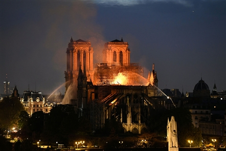 A major fire broke out at the landmark Notre-Dame Cathedral in central Paris on April 15, 2019, sending flames and huge clouds of grey smoke billowing into the sky.