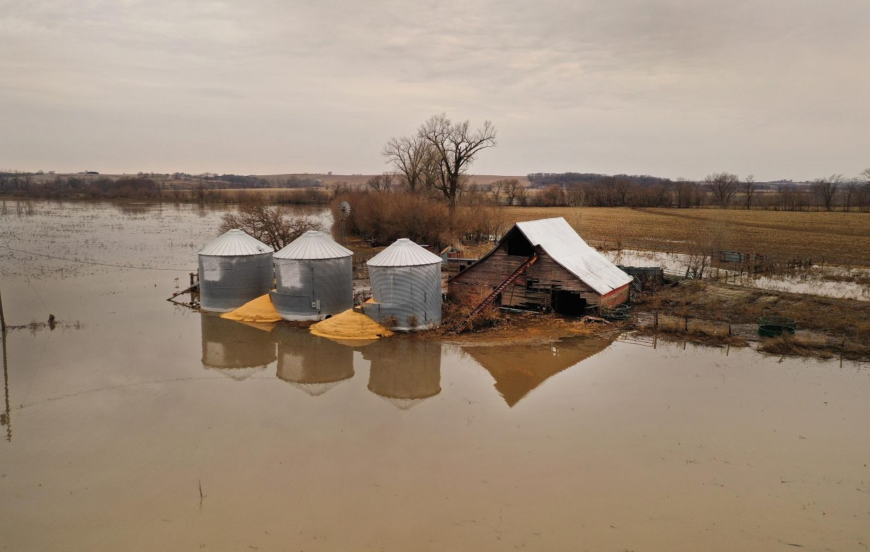 Corn bursts from a grain bin that was soaked with floodwater on March 23 near Union, Neb. Damage estimates from flooding in Nebraska top $1 billion. Getty Images)