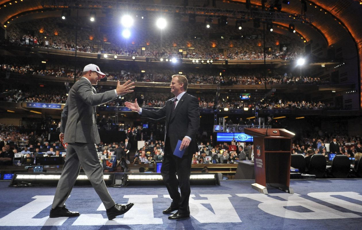Rob Gronkowski, left, is greeted by NFL Commissioner Roger Goodell after being selected in the 2010 NFL Draft at Radio City Music Hall. This year's draft is being held in Nashville. (Jason Szenes/The New York Times)
