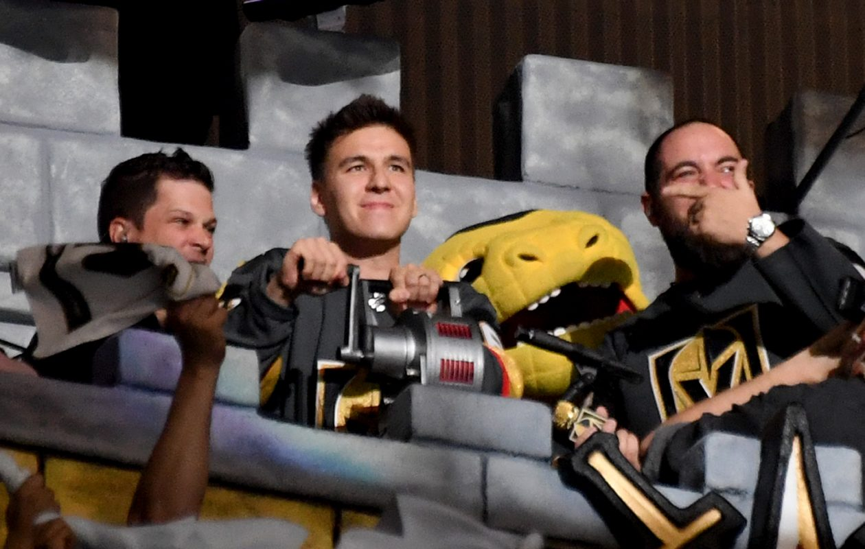 Professional sports gambler and 'Jeopardy!' champion James Holzhauer, center, sounds a siren before the start of Game Six of the Western Conference First Round between the San Jose Sharks and the Vegas Golden Knights during the 2019 NHL Stanley Cup Playoffs at T-Mobile Arena on April 21, 2019, in Las Vegas. (Ethan Miller/Getty Images)