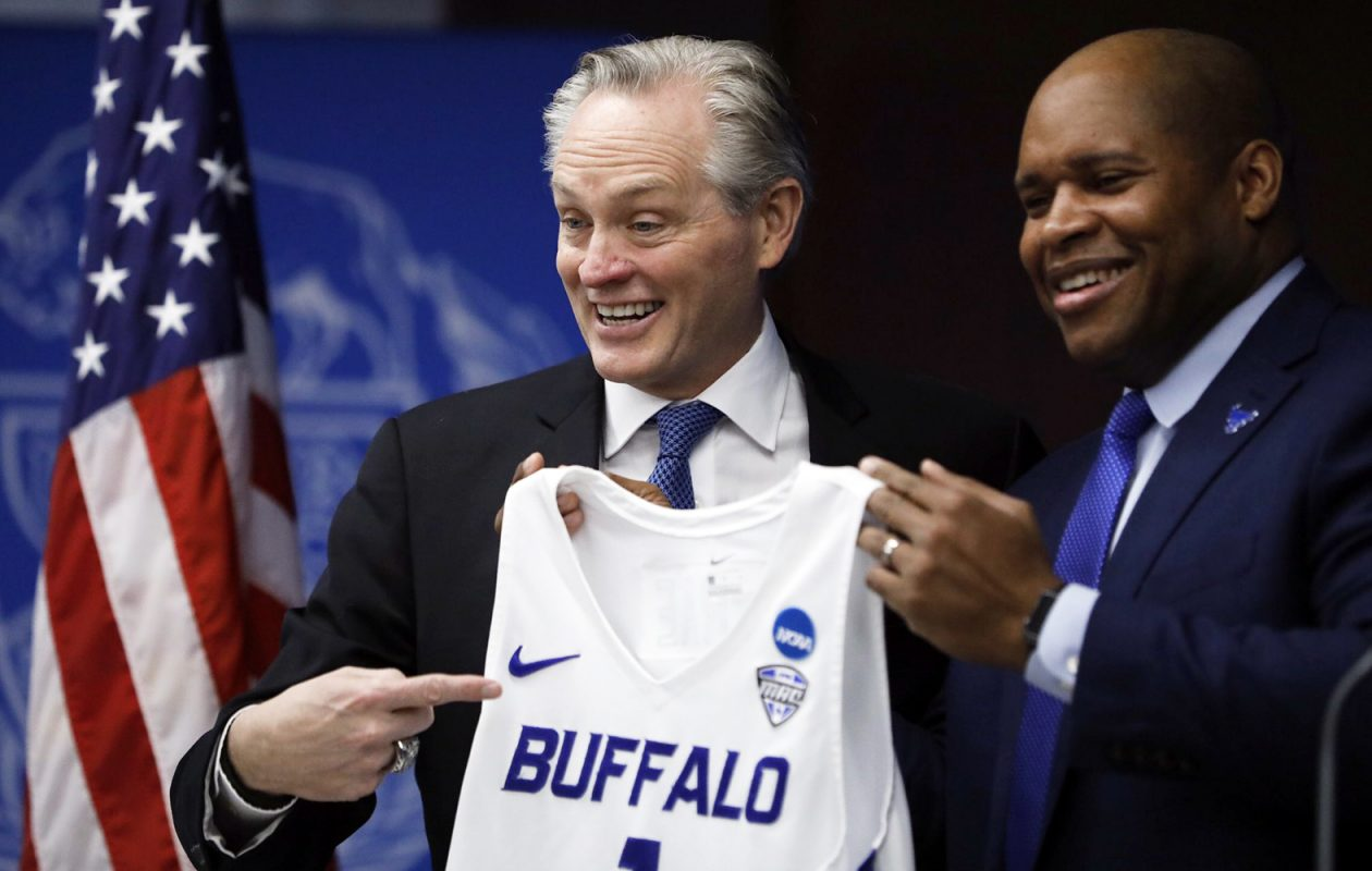 Jim Whitesell is formally introduced as the next UB men's basketball coach alongside UB Athletic Director Mark Alnutt. (Derek Gee/Buffalo News)