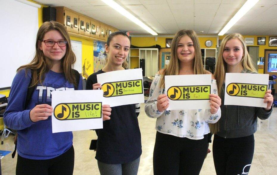 Kenmore East High School band members are collecting photos of what music means to them. From left: Jessica Fink, Megan Partsch, Mykayla Pielich and Maritsa Scepovic. (Photo courtesy Ken-Ton school district)