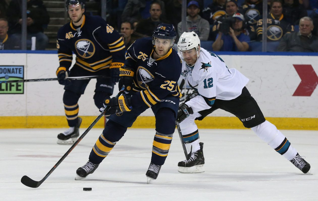 Buffalo Sabres defenseman Carlo Colaiacovo (25) battles San Jose Sharks center Patrick Marleau (12) for the puck in the first period at First Niagara Center in Buffalo, N.Y., on Saturday, Nov. 14, 2015. (James P. McCoy/Buffalo News)