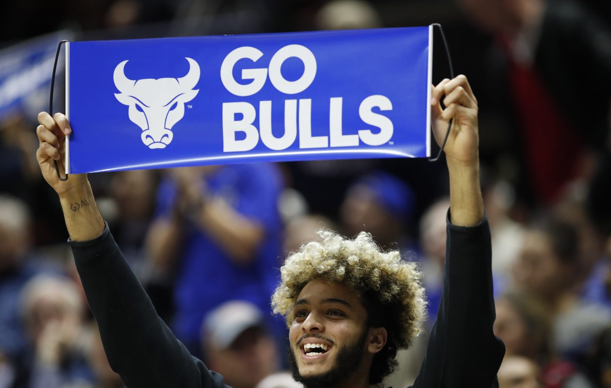 A Buffalo fan cheers on his team during the NCAA Tournament. (Harry Scull Jr./Buffalo News)