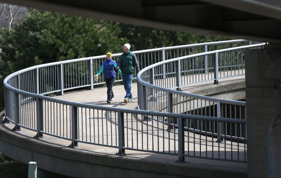Walkers on the pedestrian bridge that crosses Route 198.  (Robert Kirkham/Buffalo News)