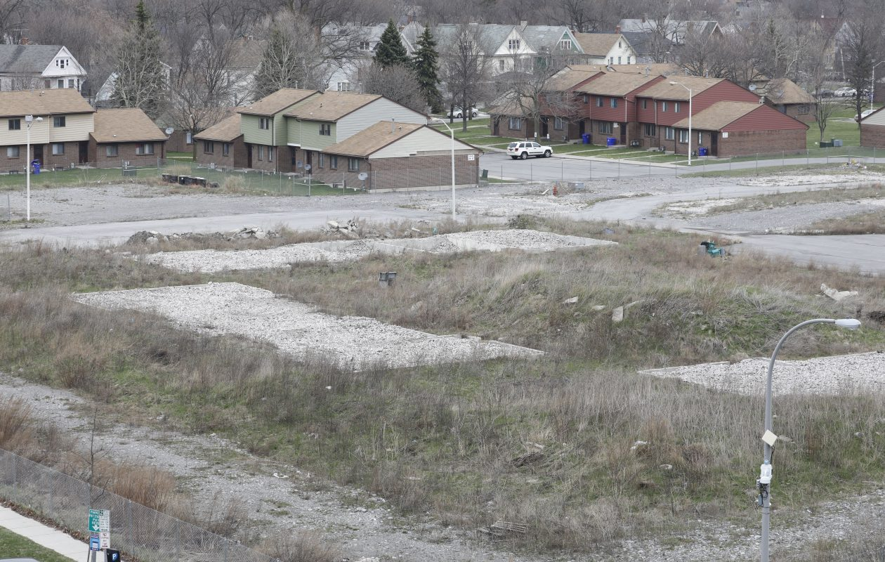 The Pilgrim Village site on the Buffalo Niagara Medical Campus. Construction on the site stalled as partners McGuire Development Co. and Mark Trammell battled in court. Many of the apartments in the background are still occupied. (Derek Gee/Buffalo News)