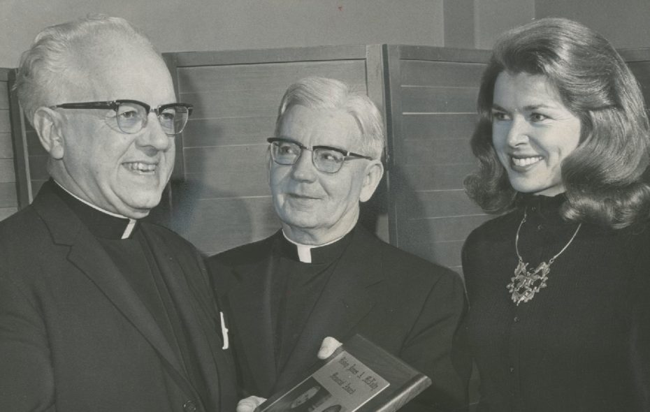 Monsignor Joseph Schieder, left, receives an award in 1958 from then-Buffalo Diocese Bishop Bernard McLaughlin for service to youth as Miss America Marilyn Van Derbur looks on. (News file photo)