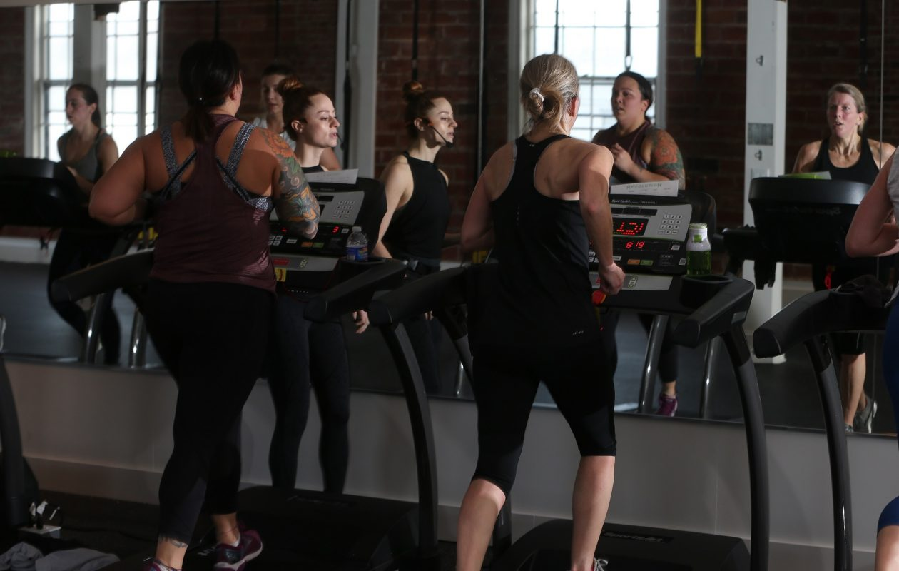 An Ignite Buffalo grant allowed Revolution Indoor Cycling to hire Kathleen Granchelli as manager. She is pictured above leading a Rev run class on the second floor of the company's expanded operation at 1716 Main St. (John Hickey/Buffalo News)