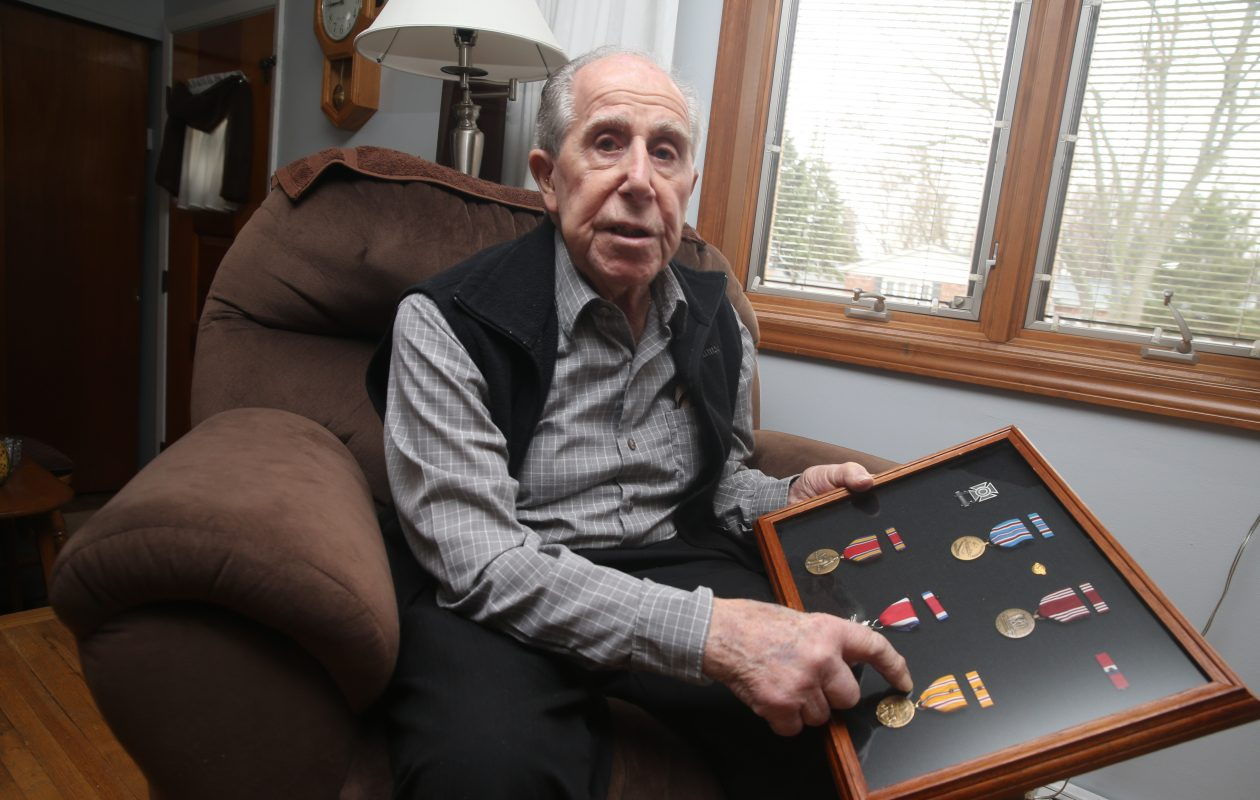 Tom Vilardo, 94, a U.S. Army veteran who served in the Philippines during World War II, at his home on Friday, April 5, 2019. Vilardo is holding a case of military medals he was awarded. (John Hickey/Buffalo News)