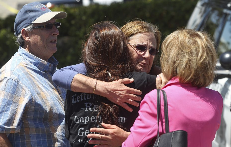 Members of the Chabad synagogue hug as they gather near the Altman Family Chabad Community Center where a man with a gun shot multiple people inside the community center, killing one, on Saturday, April 27, 2019, in Poway, Calif. (Hayne Palmour IV/San Diego Union-Tribune/TNS)