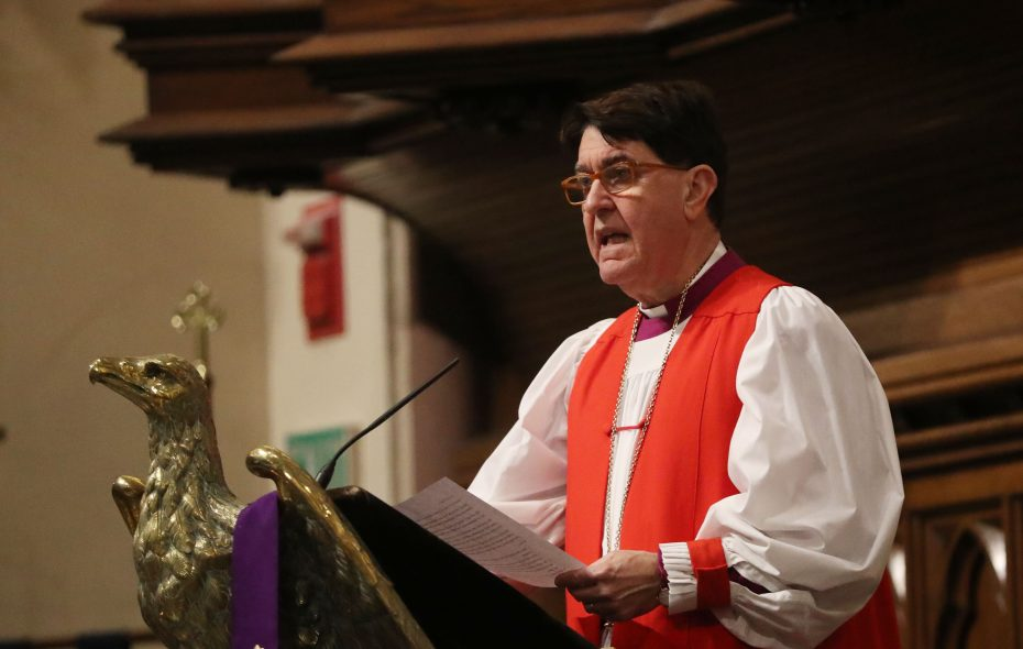 Bishop R. William Franklin of the Episcopal Diocese of Western New York offers a prayer at a service to remember students lost to gun violence, from Columbine to Sandy Hook and Parkland, during a candlelight vigil at St. Paul's Episcopal Cathedral in Buffalo on March 1, 2018. Franklin is retiring Sunday, April 7, 2019 as the diocese's leader after eight years. (Sharon Cantillon/News file photo)